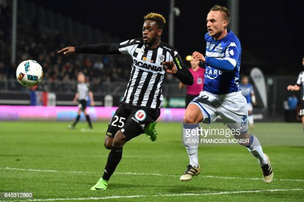 Angers'ItalyIvory Coast Abdoulaye Bamba vies with Bastia's Swedish midfielder Pierre Bengtsson during the French L1 football match between Angers and...