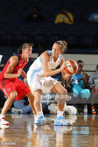 Angie Bjorklund of the Chicago Sky drives on Kelly Miller of the Washington Mystics during the WNBA game on July 5 2011 at the AllState Arena in...