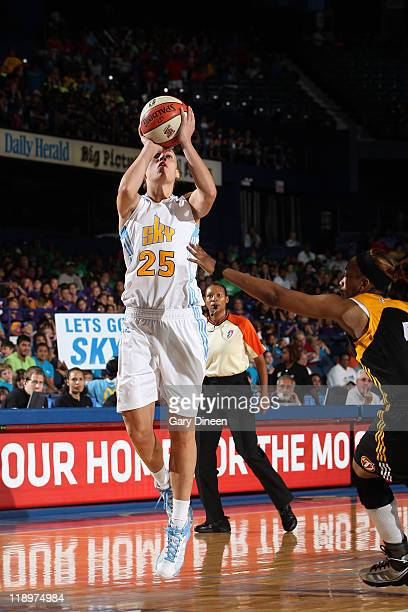 Angie Bjorklund of the Chicago Sky puts up a shot over Amber Holt of the Tulsa Shock during the WNBA game on July 13 2011 at the AllState Arena in...