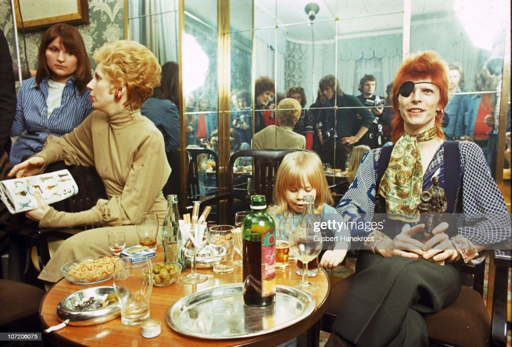 <a gi-track='captionPersonalityLinkClicked' href=/galleries/search?phrase=Angie+Bowie&family=editorial&specificpeople=679525 ng-click='$event.stopPropagation()'>Angie Bowie</a>, Zowie Bowie (<a gi-track='captionPersonalityLinkClicked' href=/galleries/search?phrase=Duncan+Jones+-+Film+Director&family=editorial&specificpeople=7554328 ng-click='$event.stopPropagation()'>Duncan Jones</a>) and <a gi-track='captionPersonalityLinkClicked' href=/galleries/search?phrase=David+Bowie&family=editorial&specificpeople=171314 ng-click='$event.stopPropagation()'>David Bowie</a> (wearing an eyepatch) appear at a press conference at the Amstel Hotel on 7th February 1974 in Amsterdam, Netherlands.