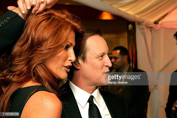 Angie Everhart and Patrick McMullan during Olympus Fashion Week Spring 2005 Kick Off Party and Book Launch for Patrick McMullan's 'InTents' at Saks...