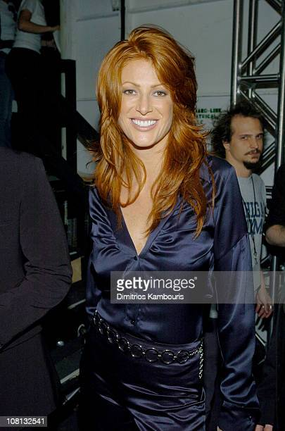 Angie Everhart during Olympus Fashion Week Spring 2005 Luca Luca Front Row and Backstage at Theater Tent Bryant Park in New York City New York United...