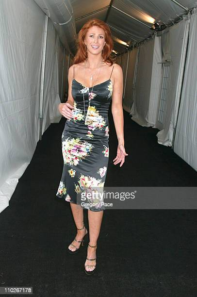Angie Everhart during Olympus Fashion Week Spring 2006 Fashion For Relief Backstage and Front Row at Bryant Park in New York City New York United...
