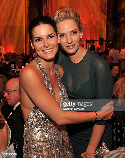 Angie Harmon and Uma Thurman pose at 2011 UNICEF Snowflake Ball at Cipriani 42nd Street on November 29 2011 in New York City