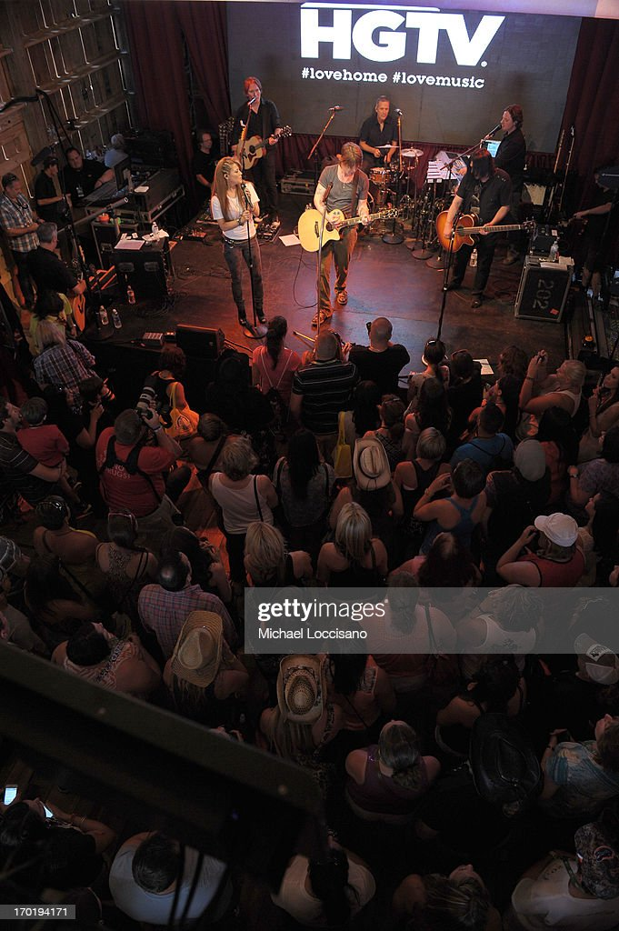 Angie Johnson, John Rzeznik, Robby Takac and Mike Malinin of the Goo Goo Dolls perform at HGTV'S The Lodge At CMA Music Fest - Day 3 on June 8, 2013 in Nashville, Tennessee.