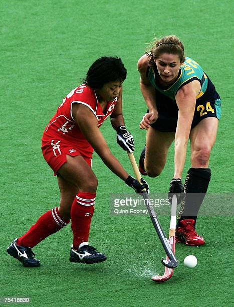 Angie Lambert of Australia tackles Sachimi Iwao of Japan during the third test match of the six test series between Australian Hockeyroos and Japan...