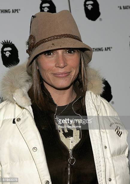 Angie Martinez attends the store opening of 'Nigo's A Bathing Ape' with Pharrell Williams after party at the Canal Room January 11 2005 in New York...