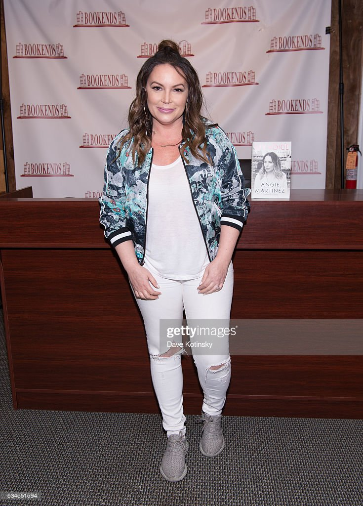 <a gi-track='captionPersonalityLinkClicked' href=/galleries/search?phrase=Angie+Martinez&family=editorial&specificpeople=664057 ng-click='$event.stopPropagation()'>Angie Martinez</a> signs copies of her new book 'The Voice' at Bookends Bookstore on May 26, 2016 in Ridgewood, New Jersey.