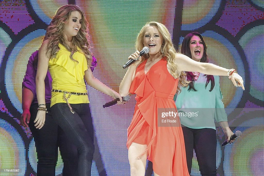 Angie Miller and Janelle Arthur performs during American Idol Live! 2013 at Bridgestone Arena on August 31, 2013 in Nashville, Tennessee.
