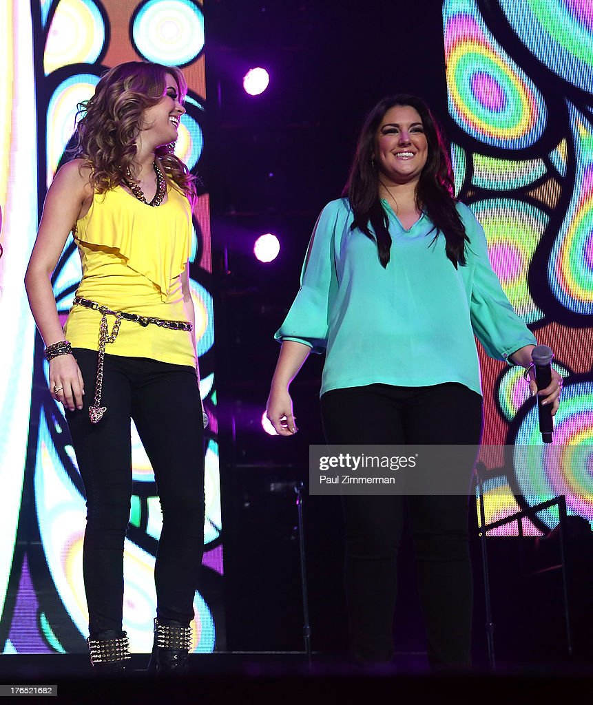 Angie Miller and <a gi-track='captionPersonalityLinkClicked' href=/galleries/search?phrase=Kree+Harrison&family=editorial&specificpeople=10539034 ng-click='$event.stopPropagation()'>Kree Harrison</a> perform during American Idol Live! 2013 at Prudential Center on August 14, 2013 in Newark, New Jersey.