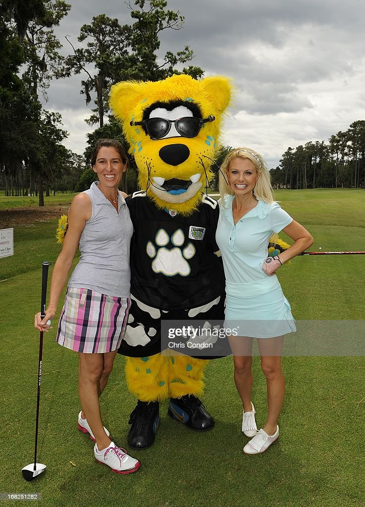 Angie Oberholser and Win McMurray pose with Jacksonville Jaguars mascot Jaxson DeVille on the first hole during PGA TOUR Wives Classic golf tournament held on Dye's Valley course before THE PLAYERS Championship on THE PLAYERS Stadium Course at TPC Sawgrass on May 7, 2013 in Ponte Vedra Beach, Florida.