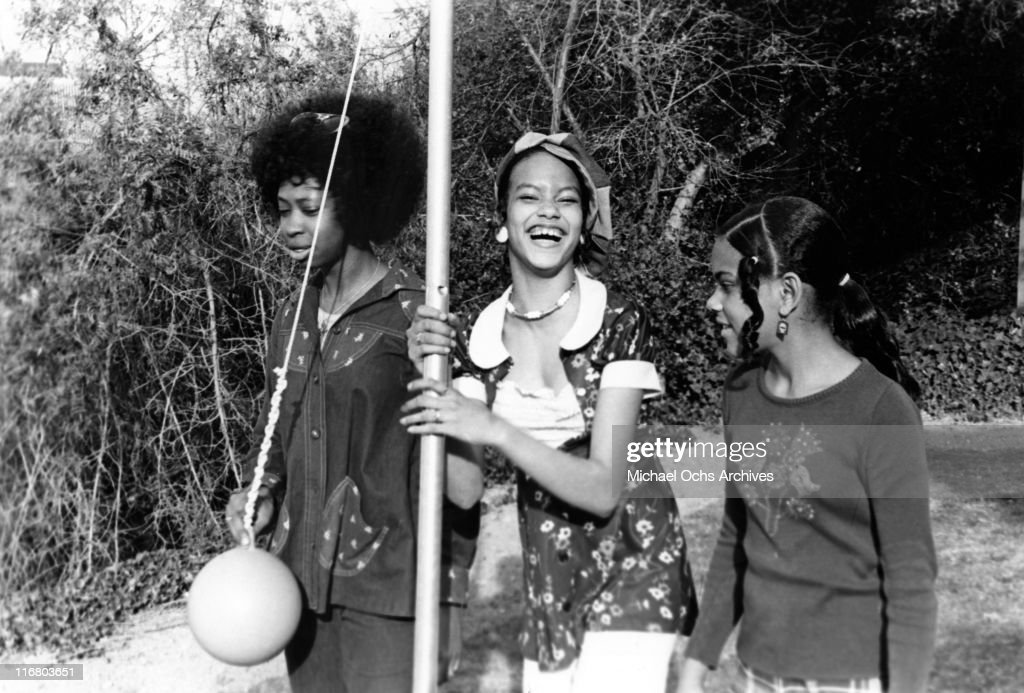 Angie Sylvers (middle) and her sister Patricia Sylvers (right) of the R and B group The Sylvers play tetherball with a friend in their garden at home on February 17, 1974 in Los Angeles, California.