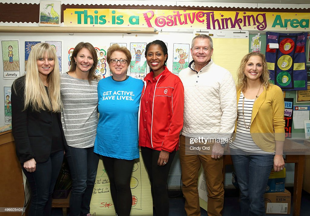 Angie Thompson Jennifer Higgins Caryl Stern Laysha Ward William Kiffmeyer and Jamie Gundrun pose for a photo together as Grammy award winner Pnk...