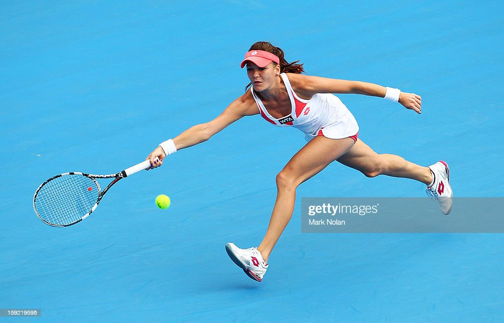 Angieszka Radwanska of Poland plays a fore hand in her semi final match against Na Li of China during day five of the Sydney International at Sydney Olympic Park Tennis Centre on January 10, 2013 in Sydney, Australia.