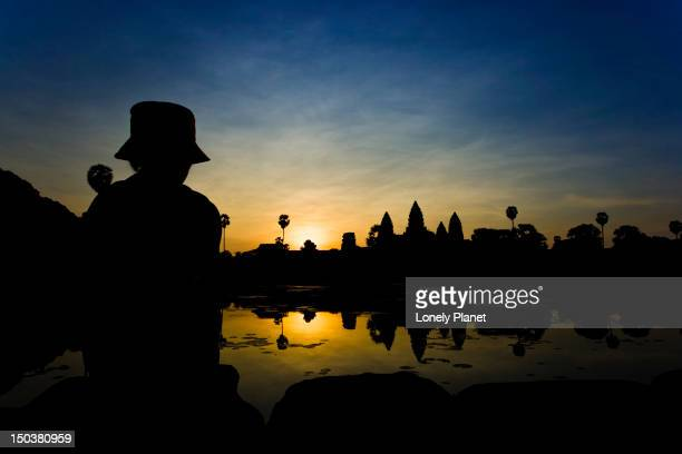 Angkor Wat silhouette at sunrise.