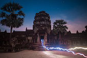 Angkor Wat Temple in Cambodia at night. The largest religious monument in the world and a World heritage listed complex, inscribed on the UNESCO World Heritage List in 1992. Ancient Khmer architecture