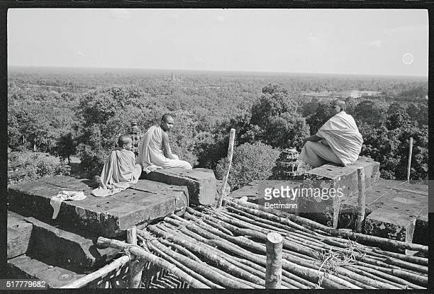 AngkorJewel of the Jungle Angkor Cambodia A trio of Buddhist monks sits atop Phnom Barkheng built by Khmer King Yacovarman during his reign between...