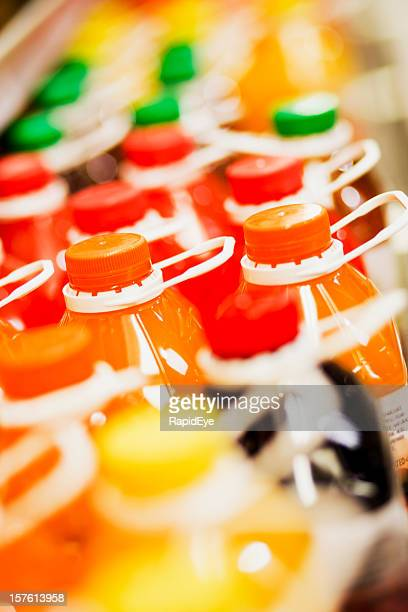Angled close up of multiple fruit juice bottles