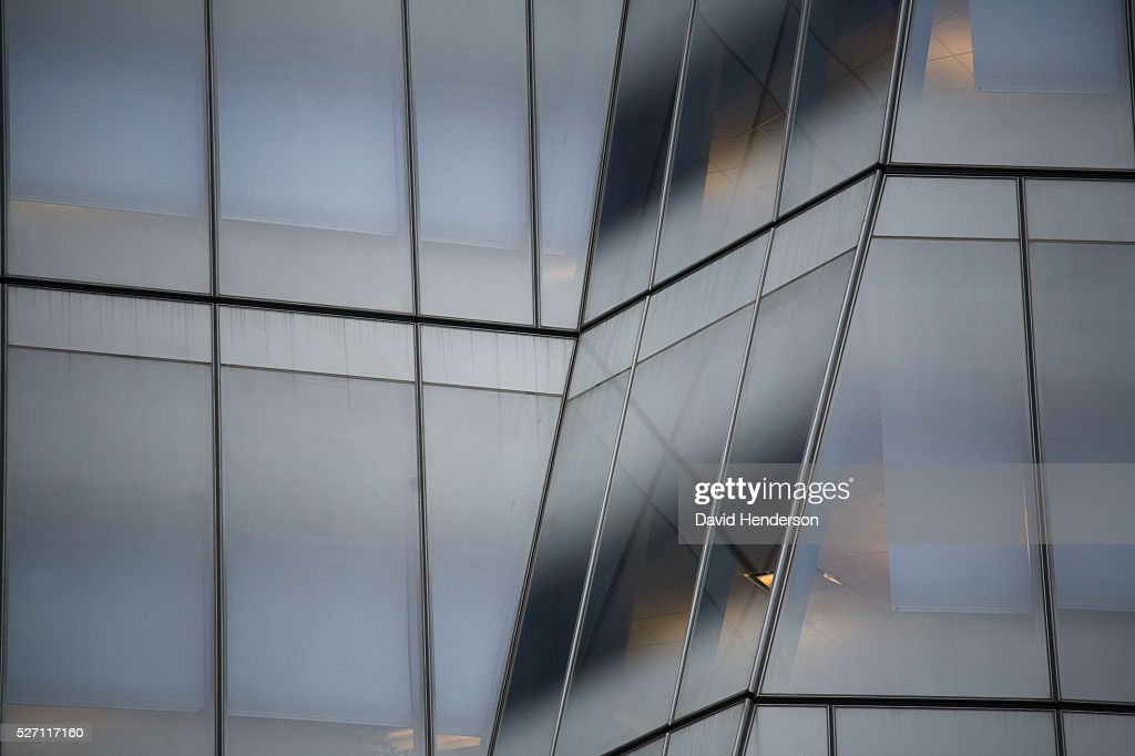 Angled glass windows on a skyscraper : Foto de stock