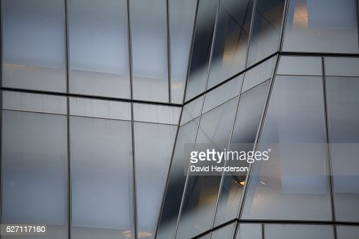 Angled glass windows on a skyscraper : Stock Photo
