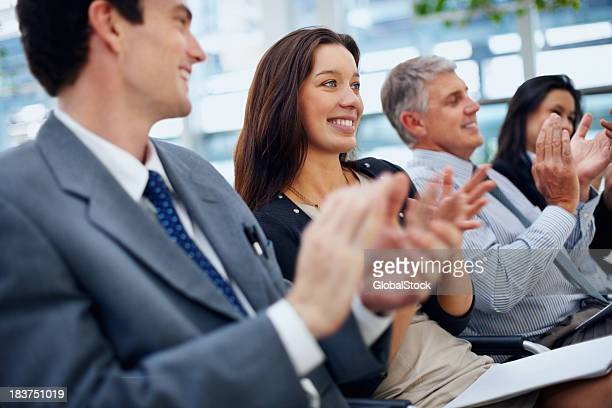 Angled view of business team clapping