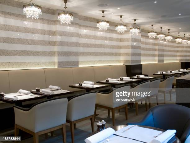 Angled view of classy restaurant with chandeliers