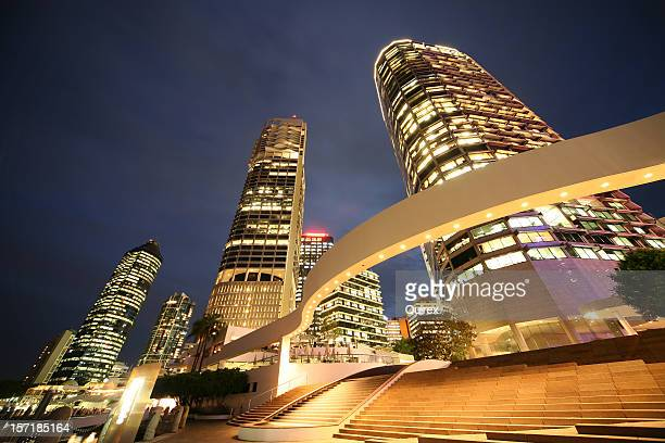 Angled view of large buildings lit up at night
