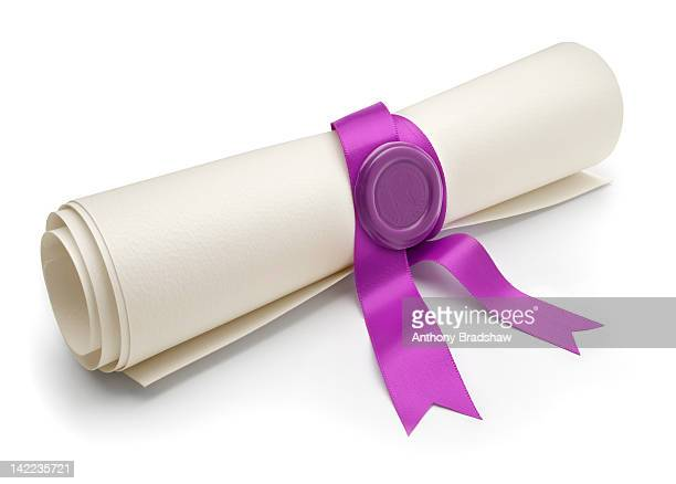Angled view of scroll with purple ribbon and seal