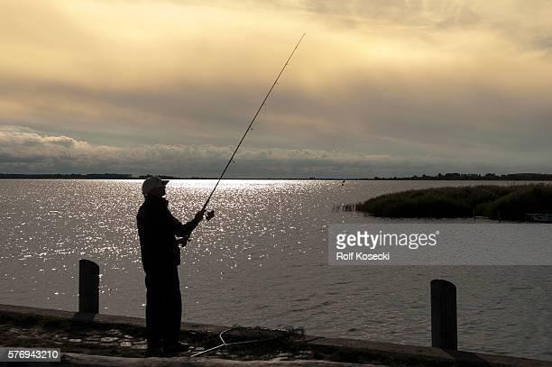 Angler im Hafen on September 25 2013 in Kuhle Germany