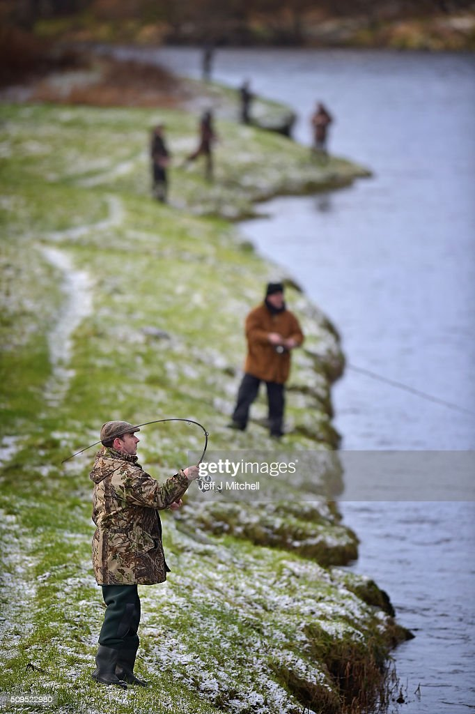Anglers fish during the opening day of the salmon season on the River Spey on February 11, 2016 in Aberlour, Scotland. The annual opening day ceremony took place at Penny Bridge, with the traditional pouring of a bottle of Aberlour twelve year old single malt Scotch whisky into the river.