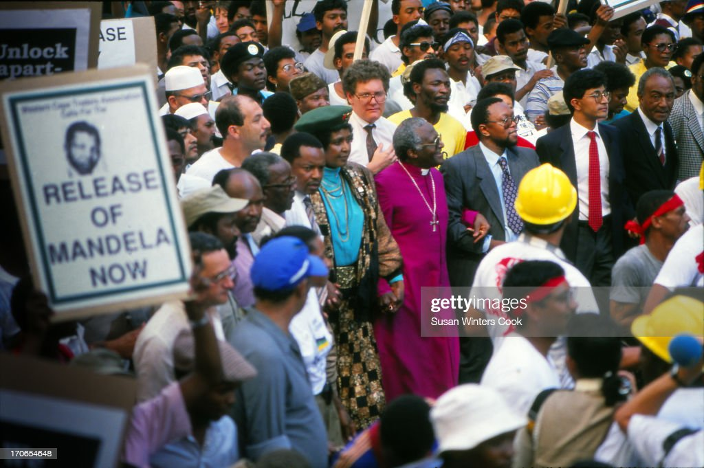 Anglican bishop Desmond Tutu and Winnie Mandela march in protest of the continued imprisonment of antiapartheid leader Cape Town South Africa 1990 On...