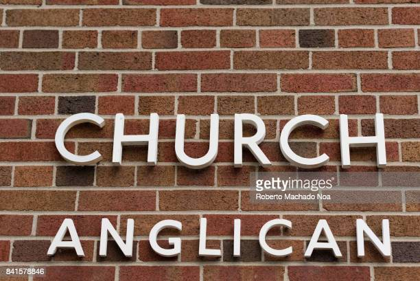 Anglican Church sign on a red brick vintage wall