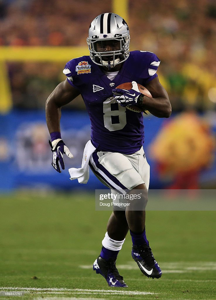 Anglo Pease #8 of the Kansas State Wildcats carries the ball against the Oregon Ducks during the Tostitos Fiesta Bowl at University of Phoenix Stadium on January 3, 2013 in Glendale, Arizona.