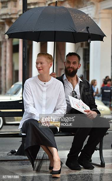AngloScottish actress performance artist model and fashion icon Tilda Swinton arrives at the Prado promenade in Havana on May 3 2016 to watch the...