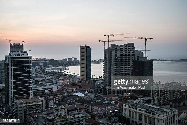 Cranes line the skyline of downtown Luanda where much of the city's wealth is concentrated A sharp decline in international oil prices has hit the...