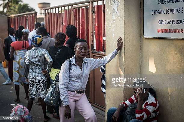 Long lines outside the Hospital Geral dos Cajueiros in Luanda's Cazenga neighborhood have led small shops to open catering for those waiting for...