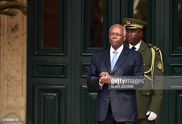 Angola President Jose Eduardo Dos Santos waits for the arrival of his French counterpart at the presidential palace on July 3 2015 in Luanda Hollande...