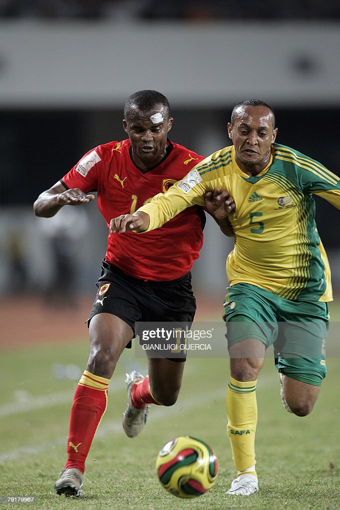 Angolan Forward Flavio Amado 'Flavio' (L) and South African Defender Nasief Morris (R) fight for the ball, 23 January 2008, during the 2008 African Cup of Nations match between South Africa and Angola at Tamale Stadium in Tamale, Ghana.