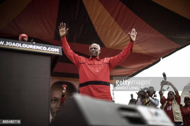 Angolan President and The People's Movement for the Liberation of Angola President Jose Eduardo dos Santos acknowledges the crowd during the closing...