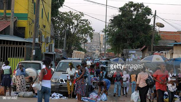 Angolans visit a market in a poor area of Luandaon January 26 2010 AFP PHOTO / ISSOUF SANOGO