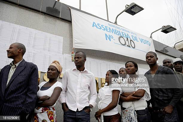 Angolans wait on August 31 2012 for their turn to vote at a polling station in the outskirts of Luanda The ruling Popular Movement for the Liberation...