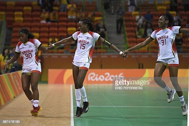 Angola's centre back Isabel Evelize W Guialo Angola's right back Azenaide Daniela Carlos and Angola's left wing Janete Viegas dos Santos celebrate...