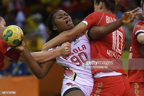TOPSHOT Angola's centre back Isabel Evelize W Guialo vies with Montenegro's centre back Andela Bulatovic during the women's preliminaries Group A...