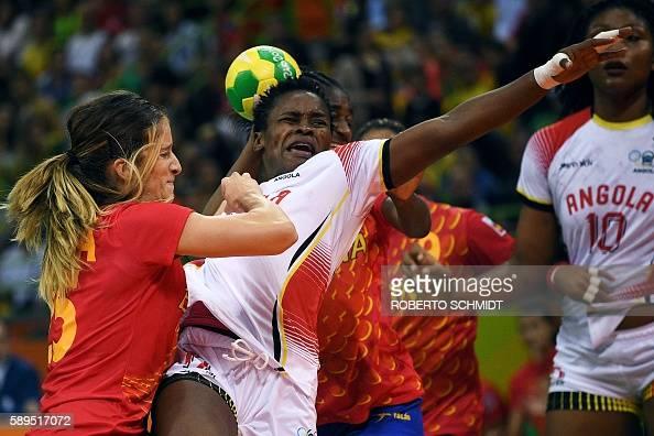 TOPSHOT Angola's centre back Natalia Maria Bernardo vies with Spain's left back Nerea Pena Abaurrea during the women's preliminaries Group A handball...