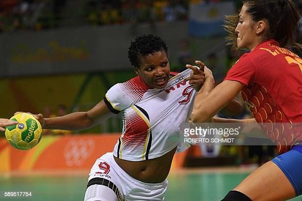 Angola's centre back Natalia Maria Bernardo vies with Spain's left back Lara Gonzalez Ortega during the women's preliminaries Group A handball match...