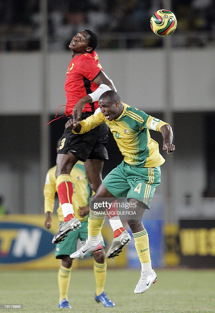 Angola's forward Maleus Alberto 'Manucho' (L) and South African defender and captain Aaron Mokoena (R) jump for the ball, 23 January 2008, during the 2008 African Cup of Nations match between South Africa and Angola at Tamale Stadium in Tamale, Ghana.