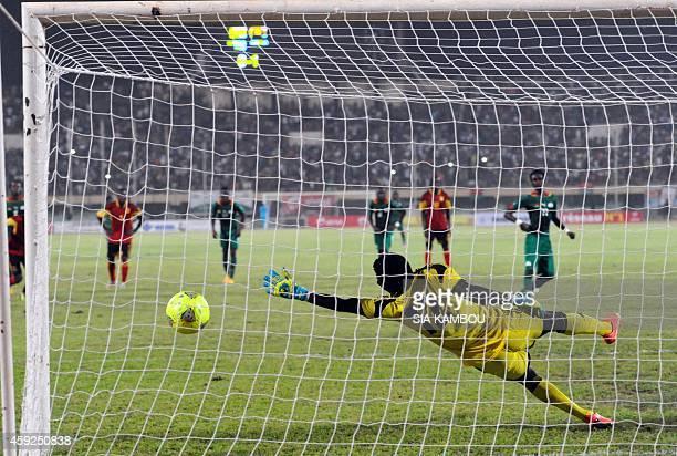 Angola's goalkeeper Landu Mavanga fails to stop a penalty kick during the 2015 Africa Cup of Nations qualifying football match between Burkina Faso...