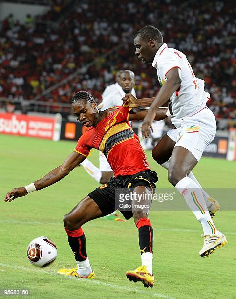 Angola's Manucho and Mali's Abdou Traore compete during the Group A African Nations Cup match between Angola and Mali at the November 11 Stadium on...