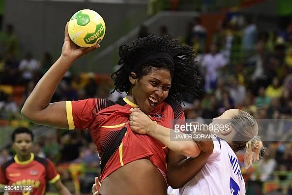 TOPSHOT Angola's pivot Albertina Cruz Kassoma vies with a Russian player during the women's quarterfinal handball match Russia vs Angola for the Rio...