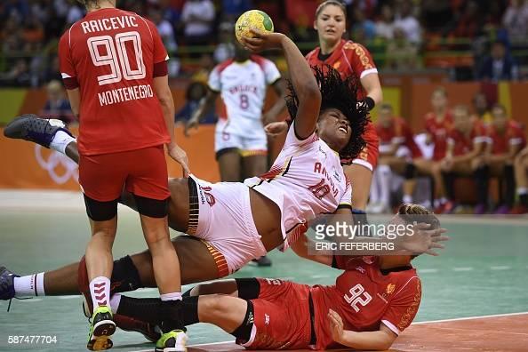 TOPSHOT Angola's pivot Albertina Cruz Kassoma vies with Montenegro's pivot Suzana Lazovic during the women's preliminaries Group A handball match...